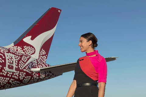 Qantas Boeing 787 tail with crew member