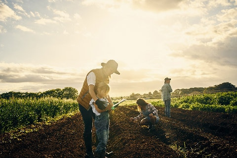 Family working on a farm