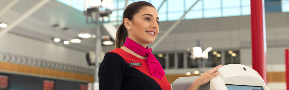 Qantas Staff at airport kiosk
