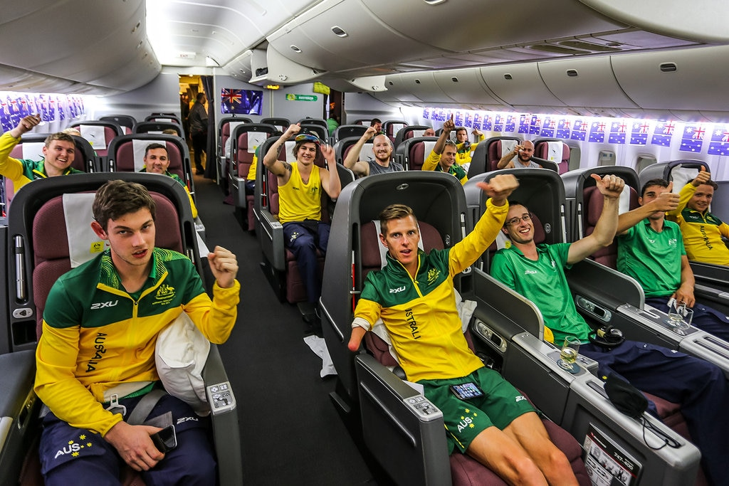 paralympics sitting in plane cabin