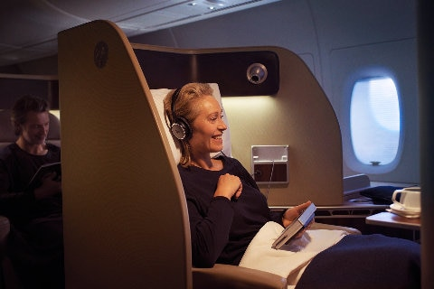 Woman relaxing in First Class on A380