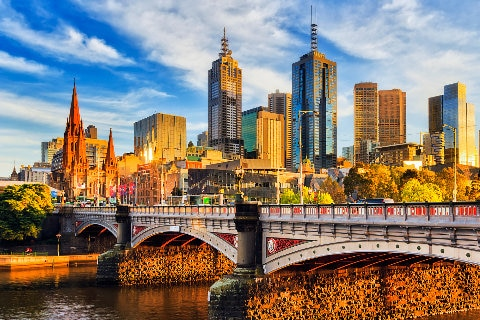 Melbourne city skyline against prince bridge on Yarra River