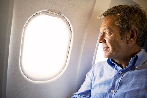 Man looking out of aircrat window